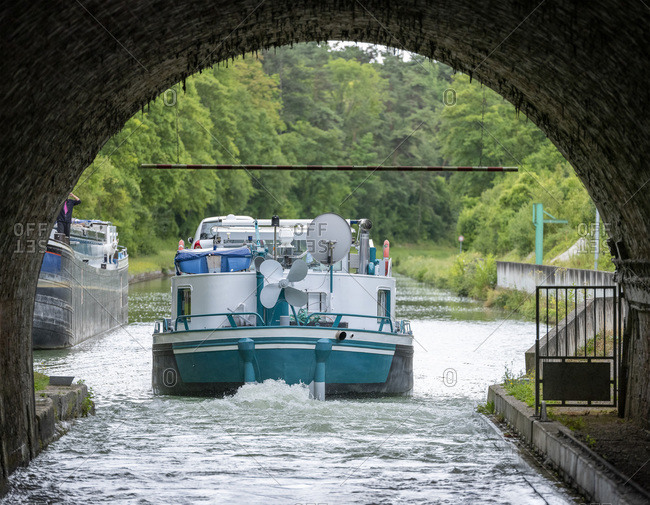 Motorboat leaving Mont-de-Billy tunnel on the canal