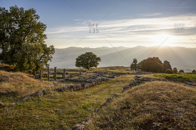Albania- Gjirokaster County- Ruins of ancient Greek city of Antigonia at sunset