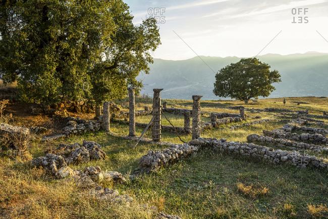 Albania-GjirokasterCounty- Ruins of ancient Greek city ofAntigoniaat sunset