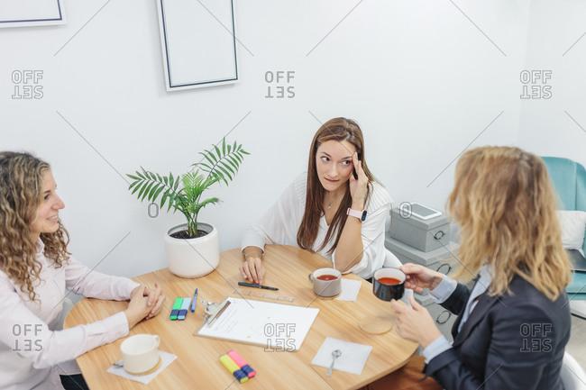 Three women sitting at office