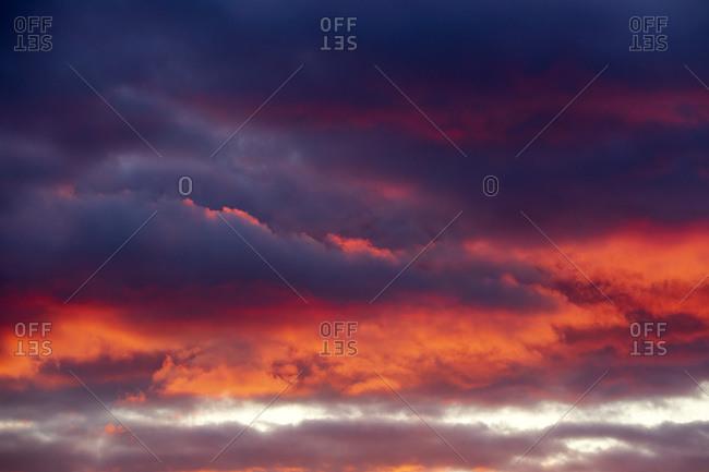 Dark clouds illuminated by setting sun