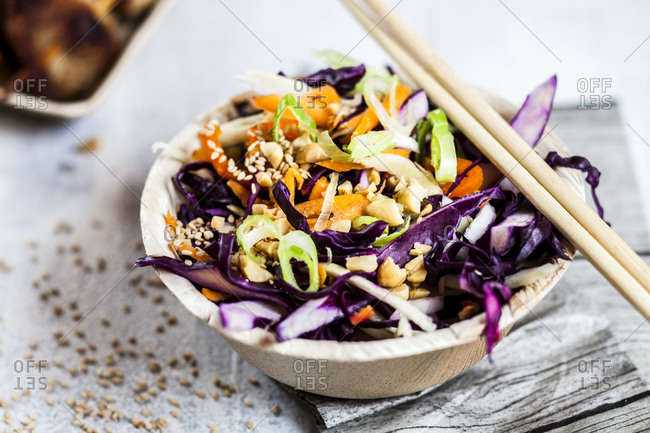 Close-up of Vietnamese cabbage salad bowl with chopsticks on table