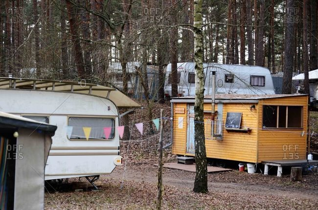 December 6, 2020: Yellow shack surrounded by campers in a caravan park