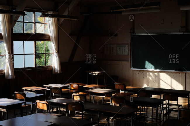 Wakayama, Japan - November 16, 2017: Sun shining through window in an empty school classroom