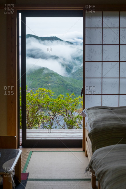 View from a hotel window overlooking cloud covered mountains in Wakayama, Japan