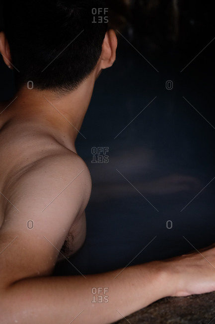 Man bathing in a Japanese onsen hot spring