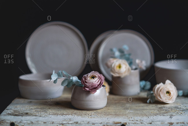 Handmade ceramic cup with flowers inside
