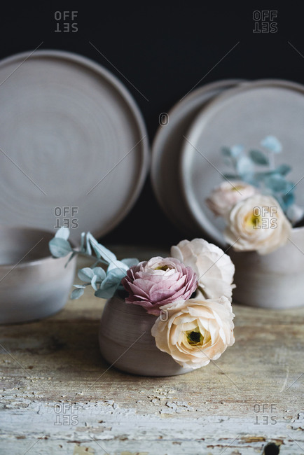 Sugar flowers made for cake decorating inside of ceramic cups
