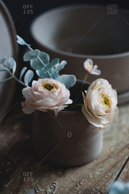 Close up of sugar flowers made for cake decorating inside of ceramic cups
