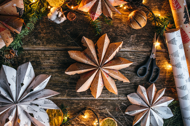Star shaped Christmas paper decoration on wooden surface