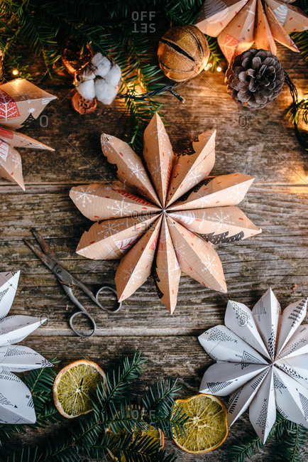Overhead view of star shaped Christmas paper decoration on wooden surface