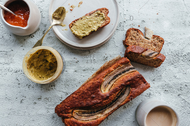 Healthy banana bread with no added sugar next to apricot jam and pistachio cream