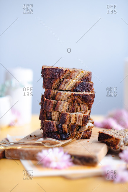 Banana bread with no added sugar sliced and stacked on cutting board