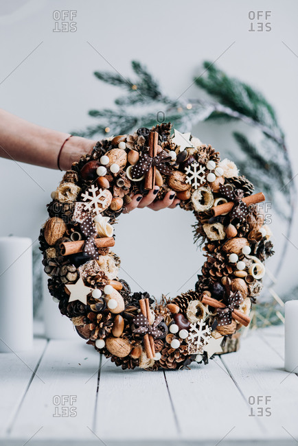 Beautiful Christmas wreath made from natural materials like cinnamon and nuts