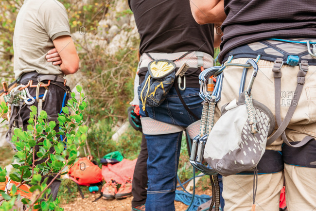 Group of mountaineers with equipment getting ready to climbing