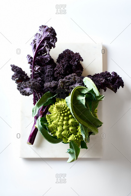 Red kale and romanesco broccoli on white background top view