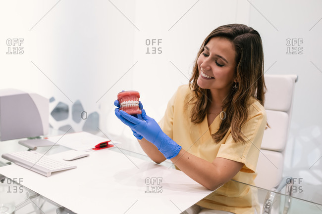 Female dentist with cosmetic braces on her hands
