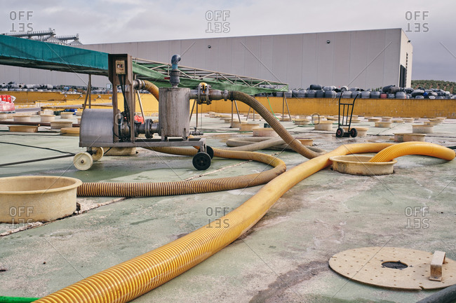 Metal construction with water and pipes placed in industrial area with tanks for purification of raw material at factory