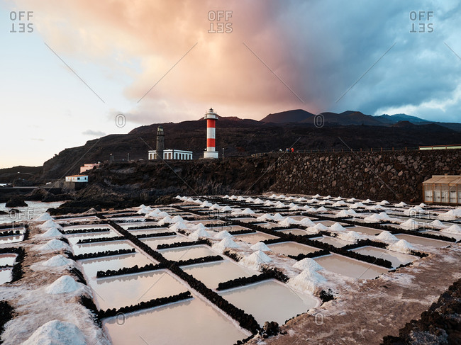 Amazing scenery of salt flats located near sea at sunset in La Palma in Spain