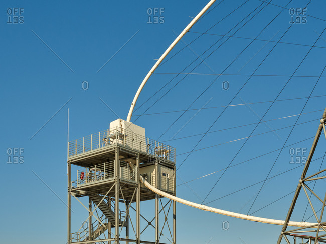 Low angle detail of large sized telescope of Cherenkov Telescope Array with metal tower and part of frame located at astronomical observatory on island of La Palma in Spain