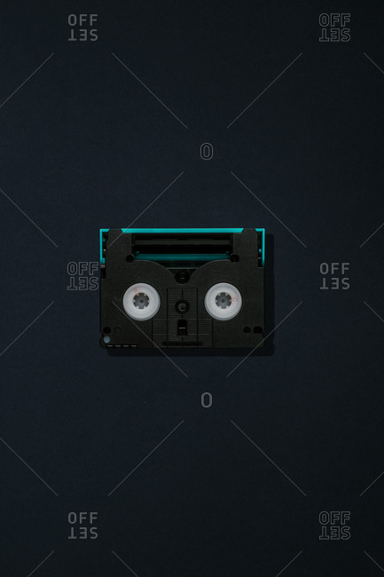 Top view of vintage compact audio tape on black background
