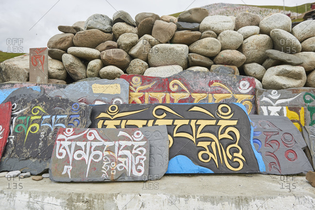 September 5, 2020: From above of big rock for praying with mantra om mani padme hum in Sanskrit placed in pile
