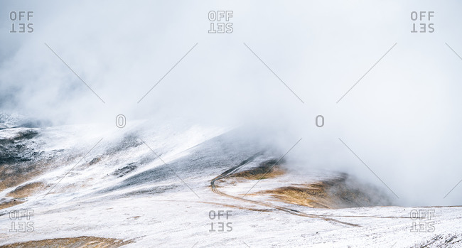 Severe cold landscape of foggy snowy Pyrenees mountains with Envalira pass in winter day