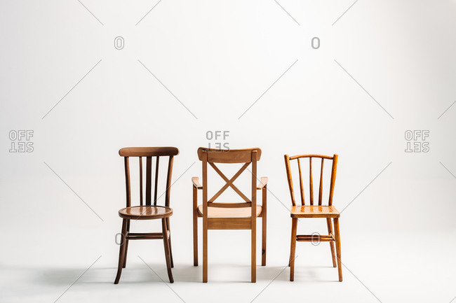 Studio shot of three classical wooden chairs