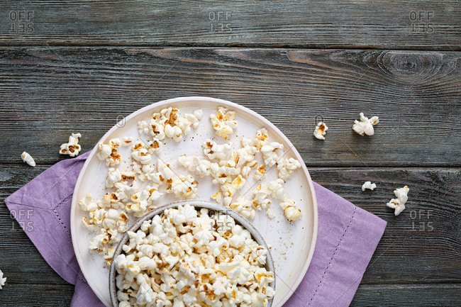 Top view of homemade popcorn in bowl on wooden table