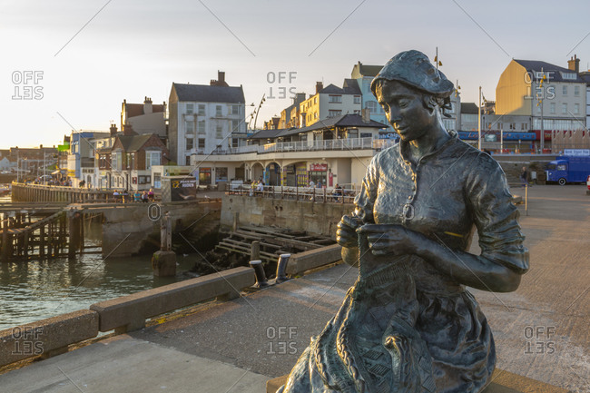 September 14, 2020: View of the Gansey Girl statue and harbor at sunset, Bridlington, East Yorkshire, England, United Kingdom, Europe