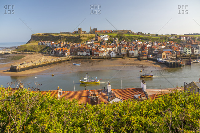 September 21, 2020: View of Whitby Abbey, St. Mary's Church and Esk riverside houses, Whitby, Yorkshire, England, United Kingdom, Europe