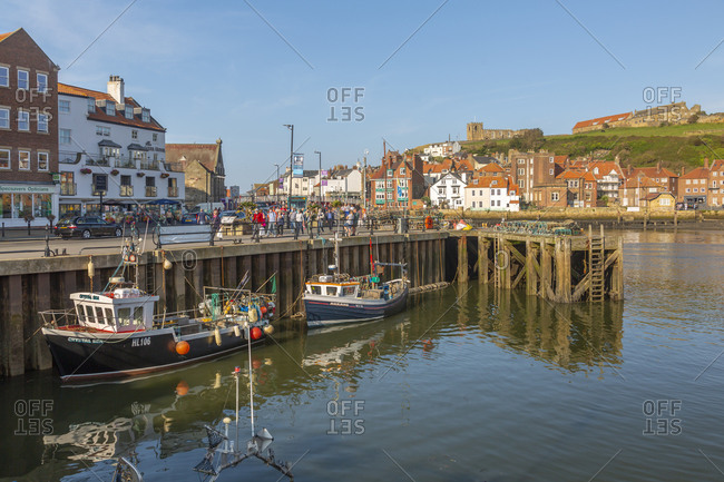 September 21, 2020: View of St. Mary's Church, houses and boats on the River Esk, Whitby, Yorkshire, England, United Kingdom, Europe