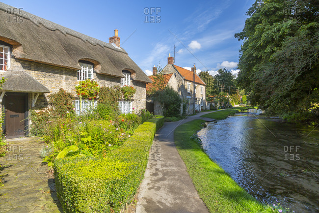 September 29, 2020: View of riverside cottages and Thornton Beck, Thornton Dale, North Yorkshire, England, United Kingdom, Europe