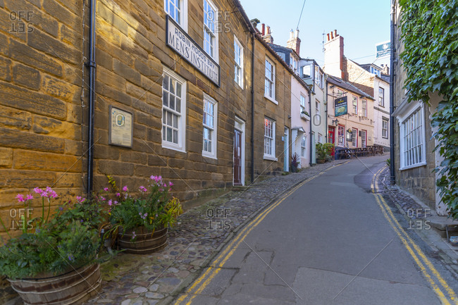 September 29, 2020: View of pastel colored houses on King Street in Robin Hood's Bay, North Yorkshire, England, United Kingdom, Europe