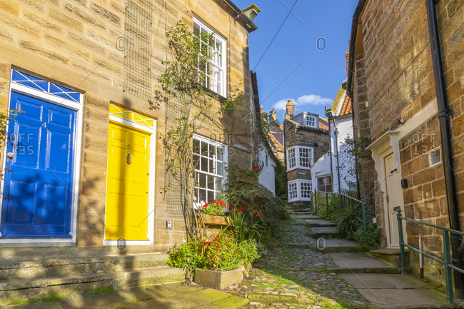 September 29, 2020: View of houses in The Opening and narrow cobbled alley in Old Bay, Robin Hood's Bay, North Yorkshire, England, United Kingdom, Europe