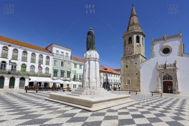 August 24, 2020: Saint John the Baptist Church, Gualdim Pais statue on Republic Square, Tomar, Santarem district, Portugal, Europe