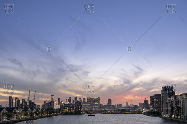 September 18, 2020: London skyline at dusk with Canary Wharf and the City of London financial districts, the Emirates Cable Car and Victoria Dock, London, England, United Kingdom, Europe