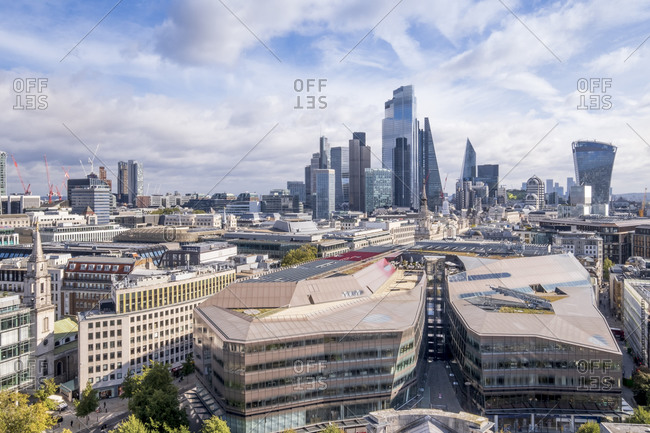 September 25, 2020: The skyscrapers of the City of London business and financial district with the One New Change shopping center in the foreground, London, England, United Kingdom, Europe