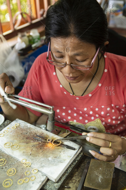 May 23, 2016: A goldsmith working in a jewelry factory, Thailand, Southeast Asia, Asia