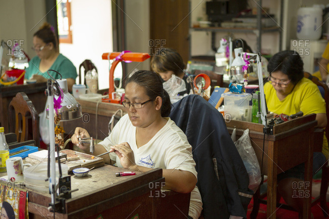 May 23, 2016: Goldsmiths working in a jewelry factory in Northern Thailand, Southeast Asia, Asia