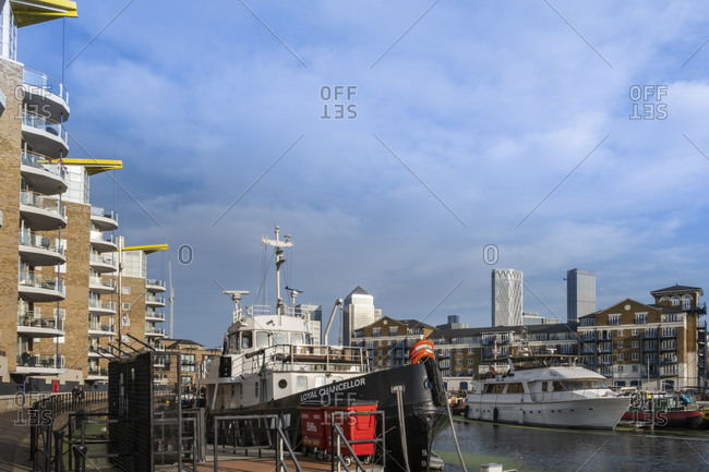 September 18, 2020: Boats moored in the marina next to modern residential apartments, Limehouse Basin, Regents Canal, Tower Hamlets, London, England, United Kingdom, Europe