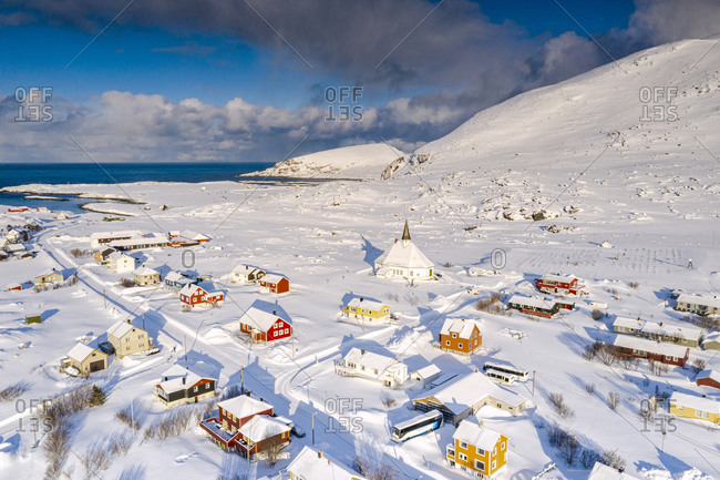 March 1, 2020: Aerial view of the fishing village of Hasvik covered with snow in winter, Soroya Island, Troms og Finnmark, Northern Norway, Scandinavia, Europe