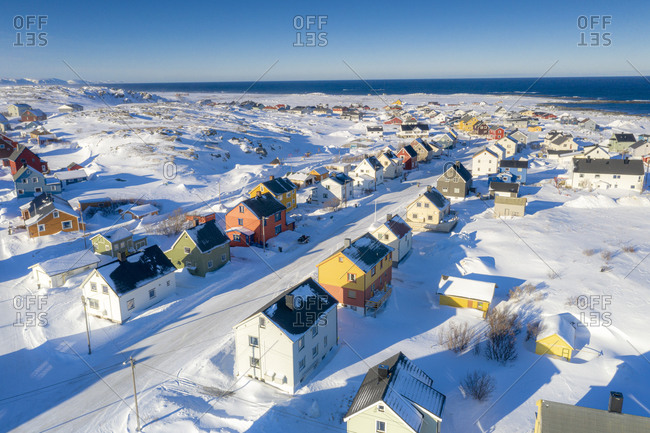 Rows of traditional colorful houses covered with snow, aerial view, Berlevag, Varanger Peninsula, Troms og Finnmark, Norway, Scandinavia, Europe