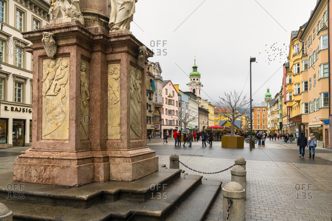 December 23, 2018: People in the famous Maria Theresien Strasse shopping street at Christmas time, Innsbruck, Tyrol, Austria, Europe