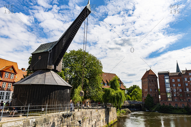 July 17, 2020: Old harbor with treadwheel crane and Altes Kaufhaus, Luneburg, Lower Saxony, Germany, Europe