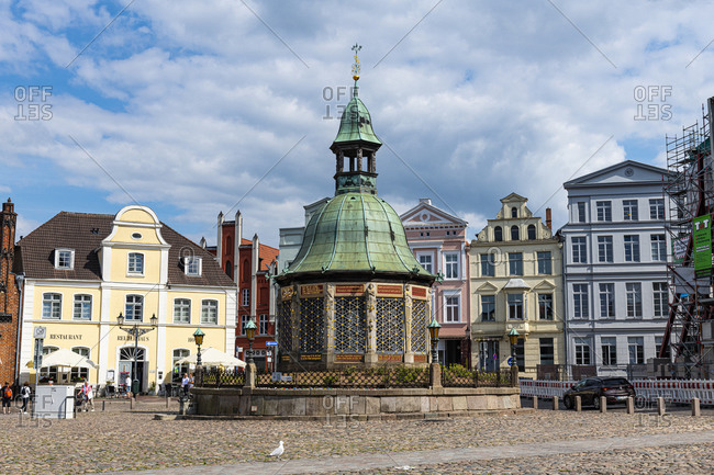 July 18, 2020: Water fountain on the market square, Hanseatic city of Wismar, UNESCO World Heritage Site, Mecklenburg-Vorpommern, Germany, Europe