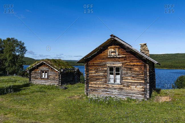 Historic houses on the Karasjohka River bordering Norway and Finland, Lapland, Finland, Europe