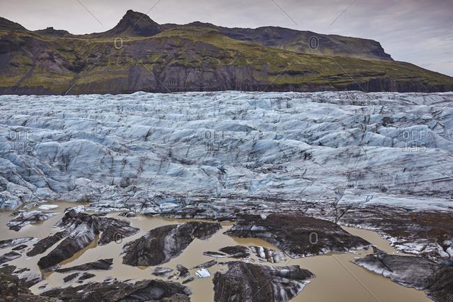 Melting ice at the foot of a retreating glacier, Svinafellsjokull, Skaftafell National Park, southern Iceland, Polar Regions