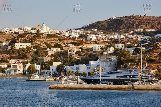 September 12, 2020: Chora and harbor of Kimolos island seen from the sea, Kimolos, Cyclades, Greek Islands, Greece, Europe