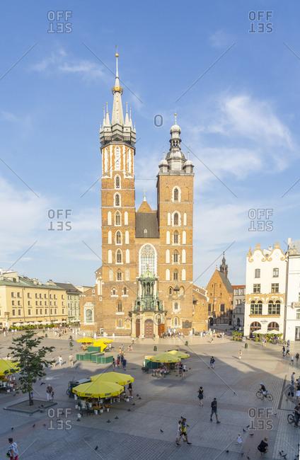 August 10, 2020: Street scene and St. Marys Basilica, UNESCO World Heritage Site, Krakow, Poland, Europe